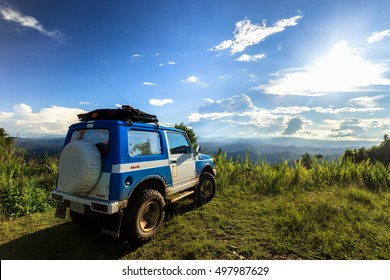 The  Off Road car on the top of mountain with blue sky