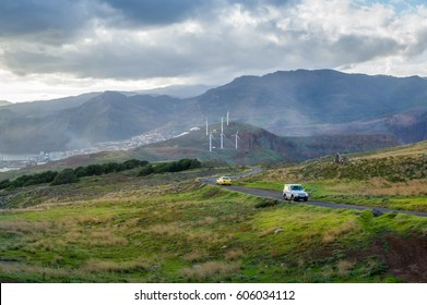 Off road car and taxi cab on the serpentine road in the beautiful landscapes of Madiera island. Portugal.