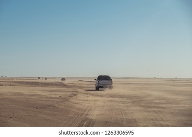 off road pick ups crossing the sahara desert off road on a sunny day