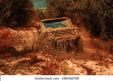 Off road sport truck between mountains landscape. Expedition offroader. 4x4 travel trekking. Best Off Road Vehicles. Rally racing