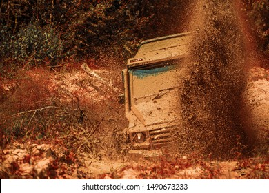 Off road sport truck between mountains landscape. Mudding is off-roading through an area of wet mud or clay. Mud and water splash in off the road racing. 4x4 travel trekking