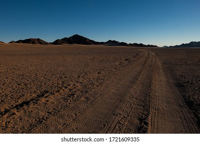 off road tracks pointing to the horizon in the namib desert close to sossusvlei - road to nowhere