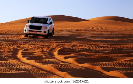 Off road vehicle on sand dunes, Oman