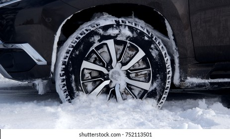 Off road winter tire packed with snow in deep snow
