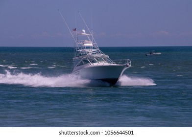 off shore boat approaching land in Florida