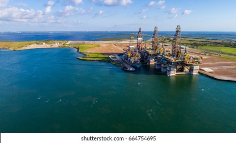 Off shore Oil Rig being constructed in Port near Corpus Christi Texas during clear sunny day at Port Aransas . Deep sea oil rig drilling causes climate change and oil spills in Gulf of Mexico
