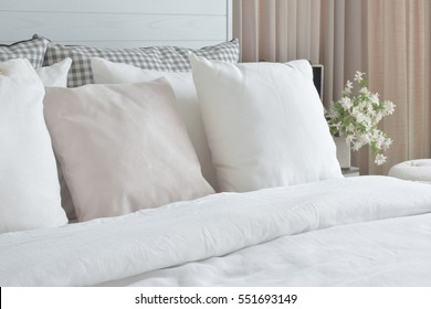 Off white pillows setting on bed with english country style bedding decoration
