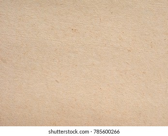 off white or yellowish paper texture useful as a background