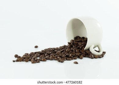 offee beans in coffee cup isolated on white