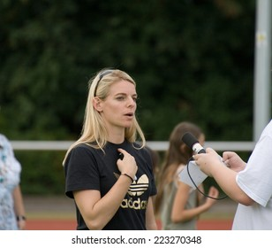 OFFENBACH, GERMANY - AUGUST, 2011: German former female soccer national player Nia Tsholofelo Kuenzer gives an interview and signs autographs for fans on August 24, 2011 in Offenbach, Germany