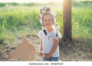 Offended adorable child play outdoors. Costume party. Child in costume for Halloween