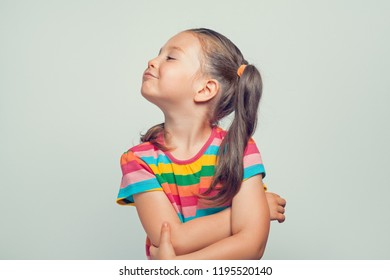 offended beautiful cute little girl turning her head to side