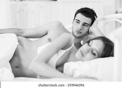 Offended couple in bed at home