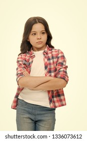 Offended feelings. Child offended keep silence. Girl serious face offended white background. Kid unhappy looks strictly. Girl folded arms on chest looks serious. Sensitive girl not want to talk.