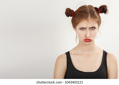 offended sad girl on a white background with copy space