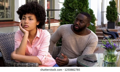Offended woman ignoring boyfriend, turned away, misunderstanding and conflict