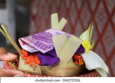 Offer for a temple flowers and money in a basket