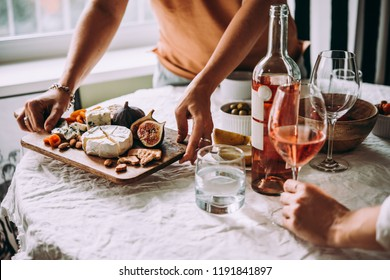 Offering appetizers at a friendly party. Dinner or aperitivo party concept.