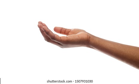 Offering or begging concept. Closeup of black female hand keeping empty cupped palm isolated on white background.