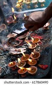 Offering candles in Dakshinkali Temple in Pharping, Nepal