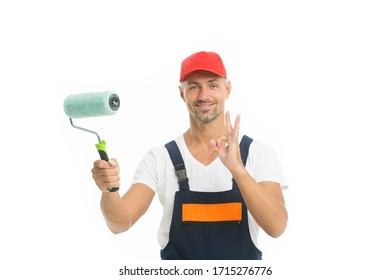 Offering professional painting services. Painter show ok sign isolated on white. Color man hold painting tool. Interior and exterior house painting. Your home requires fresh painting.
