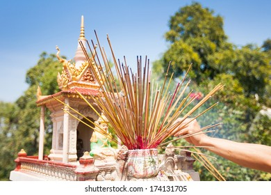 Offerings to gods in  temple with aroma sticks in Cambodia