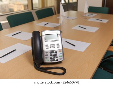Officce phone on table in meeting room