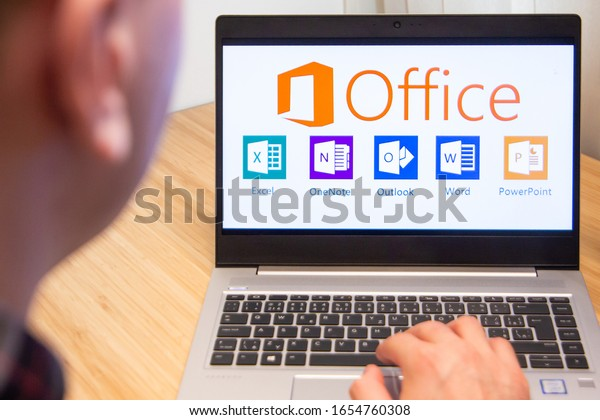 Office 365 is used by a man on the laptop. Microsoft customer used computer software. New product is tested by IT specialist. San Francisco, February 2020.