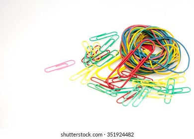 Office accessories: multi-colored paper clips for paper and an elastic band