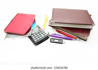 Office accessories - notebooks, pens, the calculator and compact disks on a white background