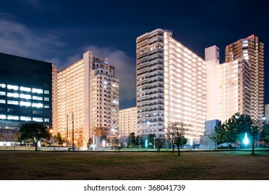Office and apartment buildings at night time in Cosmosquare Osaka