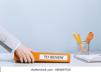 Office binder in hands. To renew text label. Business office setup with copy space