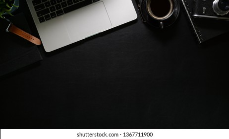 Office black leather workspace with laptop, office supplies and copy space