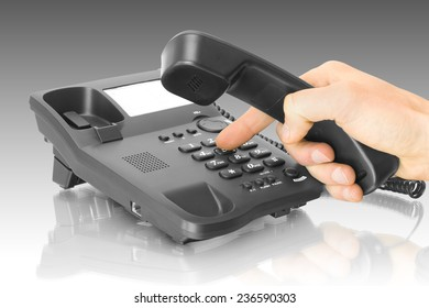 office black telephone with hand and dialing finger