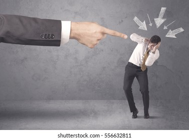 An office boss blaming young amateur and beginner business person with big hand, drawn arrows pointing at him concept