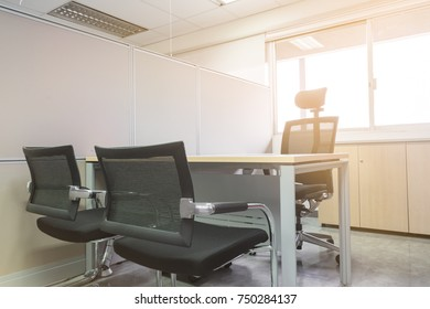 Office boss manager room with wooden table chairs sunlight form window
