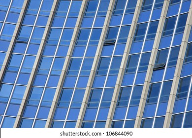 Office building with bright blue windows.