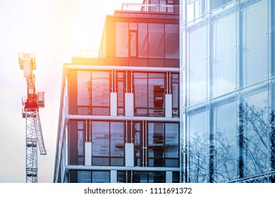 office building detail and crane with sunlight effect in vivid colors