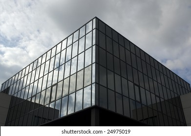 Office building with a dramatic stormy sky