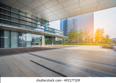 office building entrance with empty brick road,china.