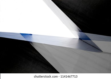 Office building fragment. Abstract modern architecture. Matte wall panels in soft backlight. Polygonal background in black, gray and light blue colors. Architectural surfaces forming sharp angle.
