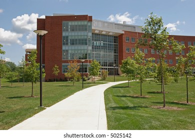 Office building and green grass with a path