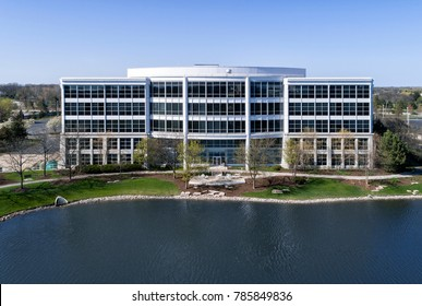 Office building headquarters in office park during spring with pond.