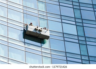 Office building maintenance, glass facade cleaning with cradle