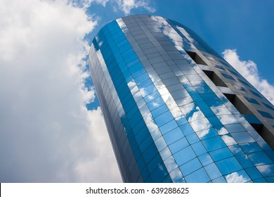 Office building on a cloudy day. Blue sky in the background. Right angle. Horizontal view.