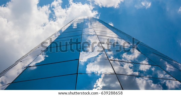 Office building on a cloudy day. Blue sky in the background. Center angle. Horizontal view.