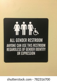An office building provides a unisex bathroom, available to all genders and identities