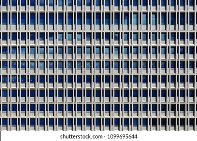 office building. steel frame and glass windows architecture. repeat rectangle pattern wall facade exterior of coporate building in Tokyo.