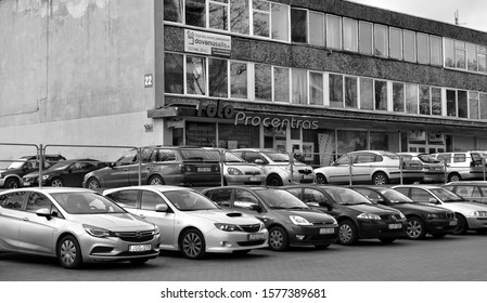 Office building surrounded by cars. Company's offices. Photo service in Vilnius. Parking area. Black and White Photography. Baltic countries. Lithuania, Vilnius - April 27, 2017