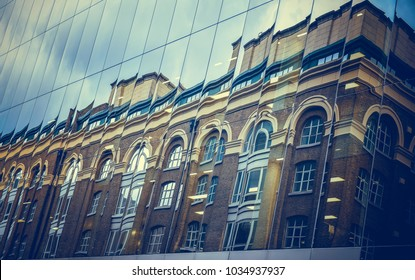 Office building windows background. Buildings reflected in windows of modern office building. Windows of the building